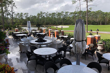 A new west-facing dedicated fire pit abuts the outdoor covered bar terrace and allows residents to enjoy stunning golf course views