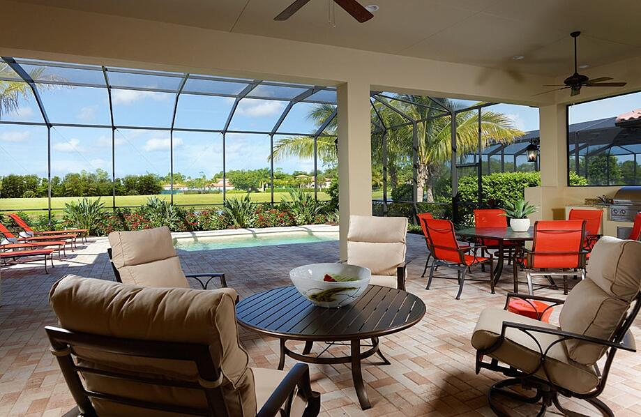 Naples Luxury Homes: The Angelica features a beautiful outdoor living space with a lake view