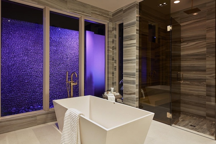 Luxurious master bathroom designs by London Bay Homes at Mediterra Naples.