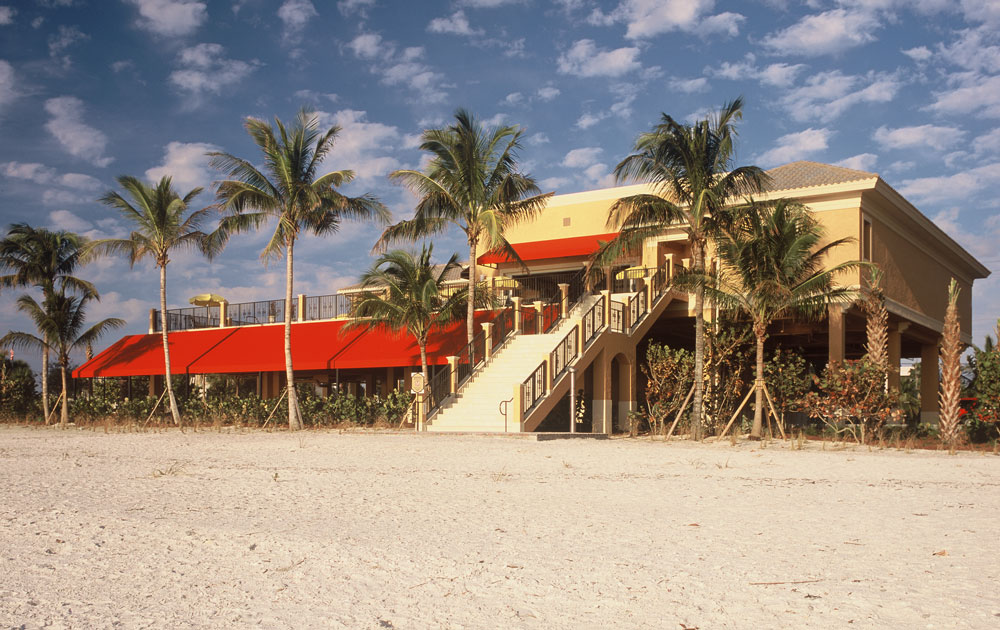 The Mediterra Beach Club offers a private beach for residents to gaze upon the sunset.