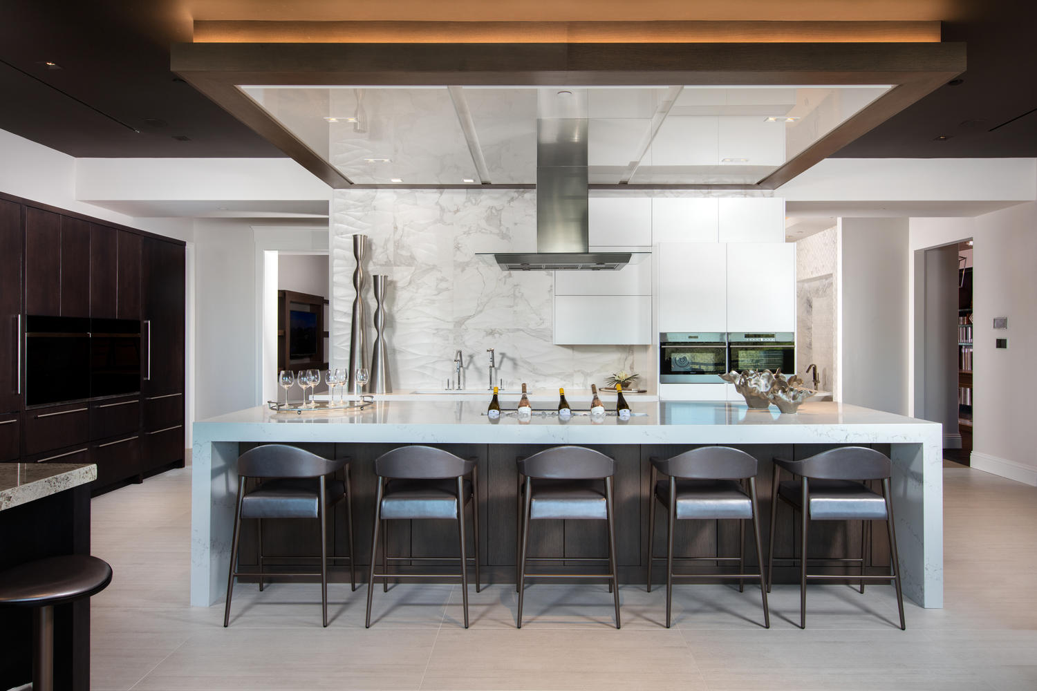 Selection Studio The fully equipped kitchen features Wolf appliances, including wall ovens, a steam oven, microwave oven, induction cooktop and Sub-Zero refrigerators.jpg