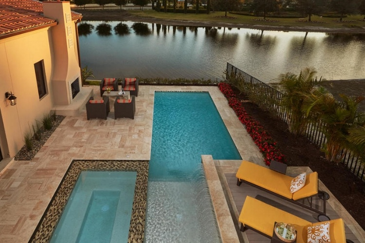 The Capriano Luxury Home in Naples features a stunning outdoor living space.